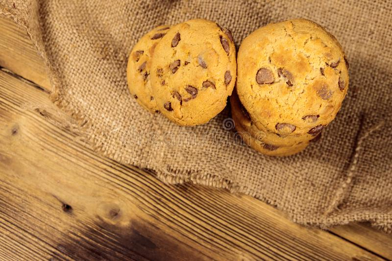 Chocolate chip cookies on wooden table. Top view stock photo