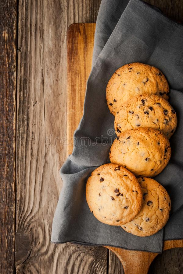 Chocolate chip cookies on the wooden table top view royalty free stock image