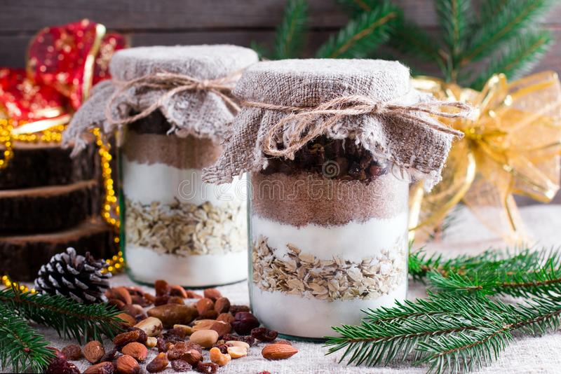 Chocolate chips cookie mix in glass jar for Christmas gift stock photo