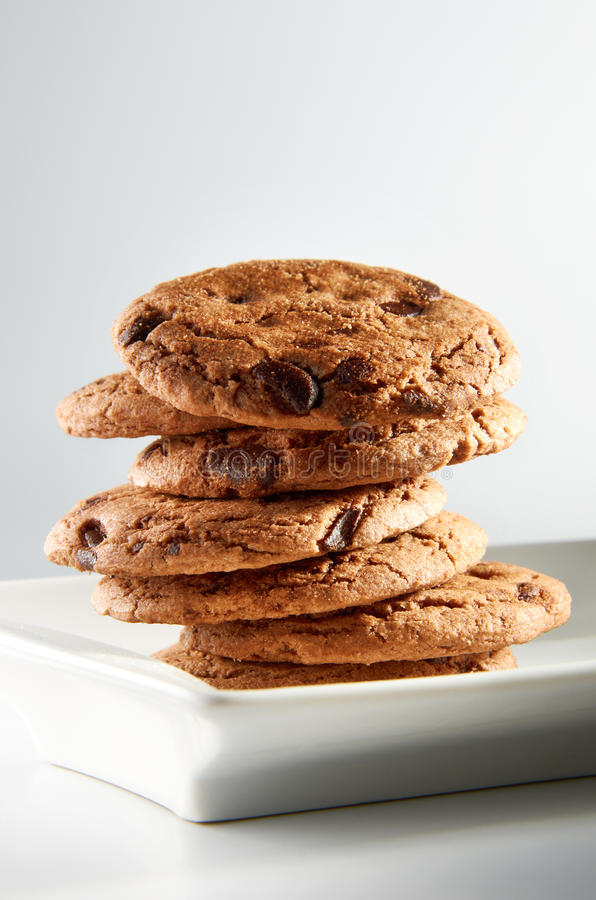 Chocolate Chips Cookies. On white plate royalty free stock photos