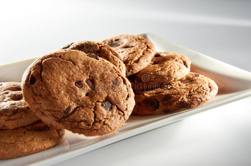 Chocolate Chips Cookies. On white plate royalty free stock images