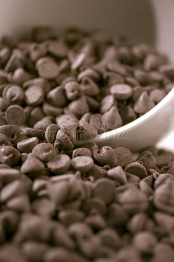 Chocolate chips overflowing stock images