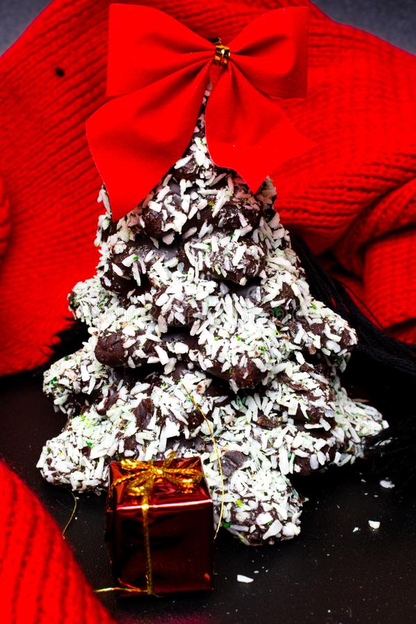 Chocolate Christmas tree with red bow and gift stock photo