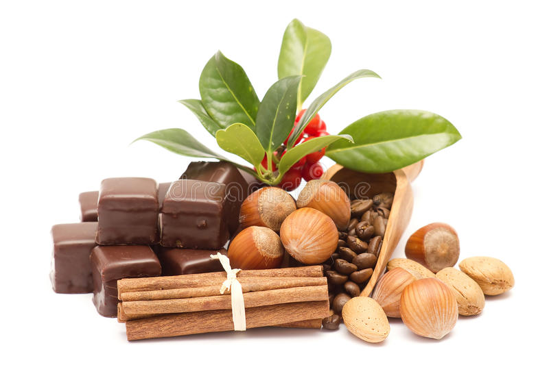 Chocolate, cinnamon, hazelnuts, coffee beans royalty free stock images