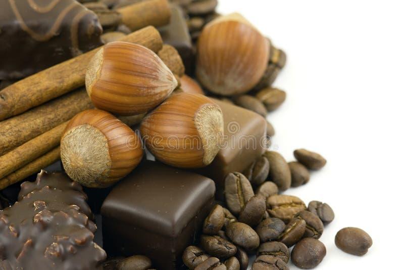 Chocolate, cinnamon, hazelnuts, coffee beans stock photography