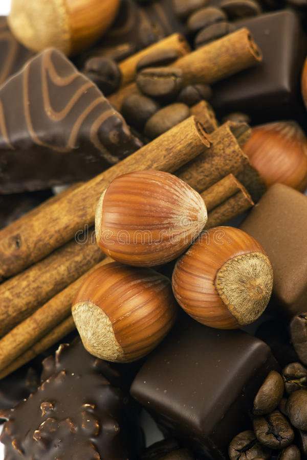 Chocolate, cinnamon, nuts, coffee beans royalty free stock photography