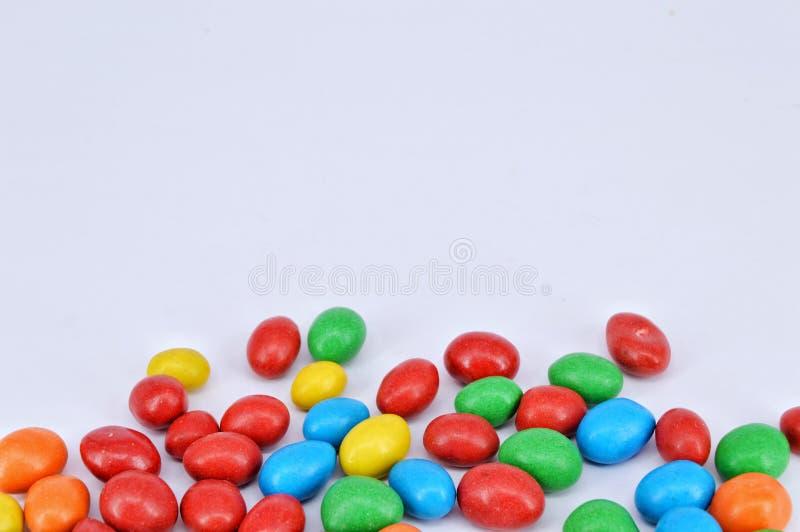 Chocolate coated peanut on white background stock photography