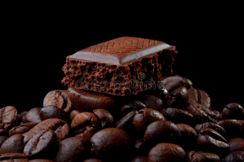 Chocolate on the coffee beans royalty free stock image