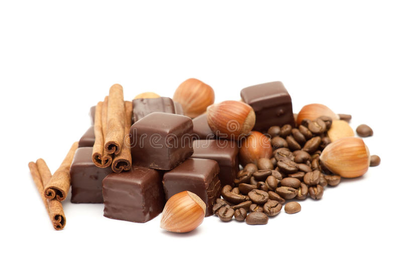 Chocolate, coffee beans, cinnamon and nuts royalty free stock image