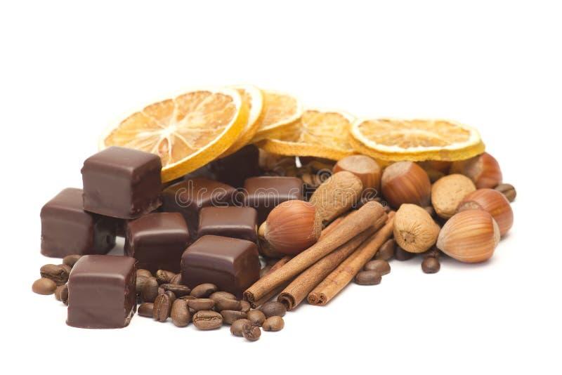Chocolate, coffee beans, cinnamon, orange royalty free stock photography