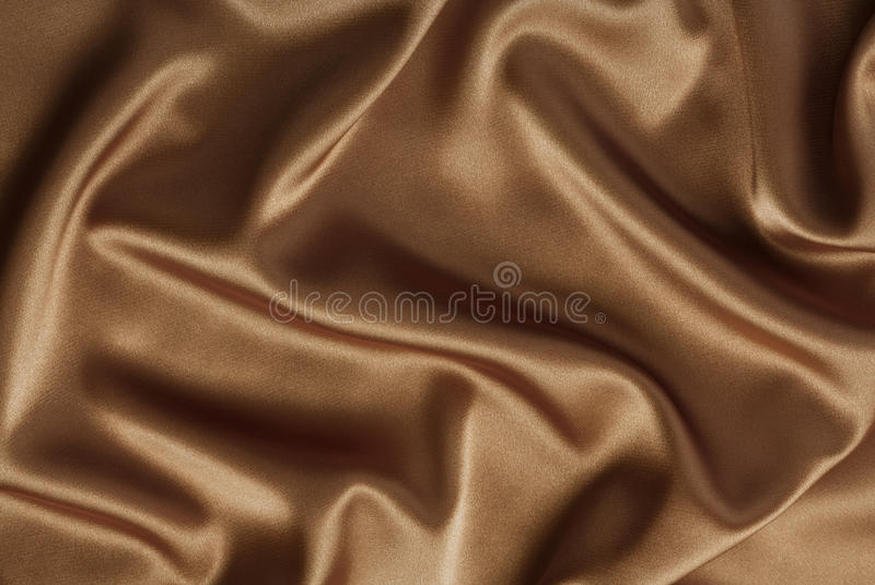 Chocolate or coffee satin or silk background royalty free stock photography