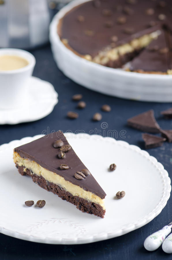 Chocolate and coffee tart. With salted caramel on a dark wooden background stock photos
