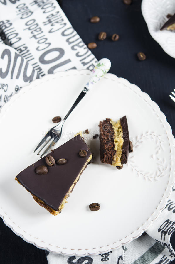 Chocolate and coffee tart. With salted caramel on a dark wooden background stock images