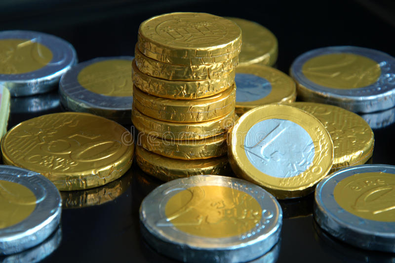 Chocolate coins with black background stock photos
