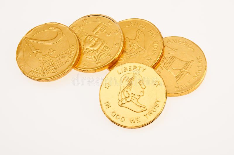 Chocolate coins in gold royalty free stock image