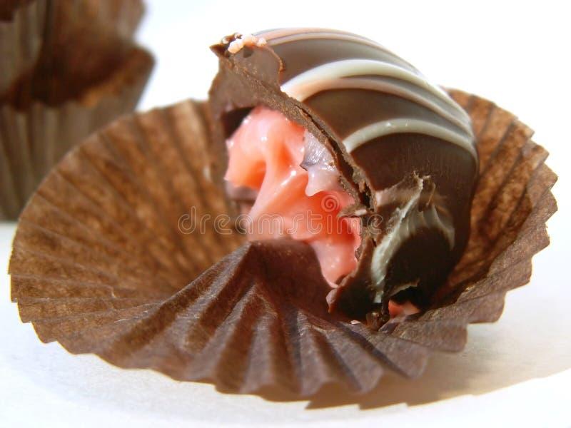 Chocolate con la mordedura imagen de archivo