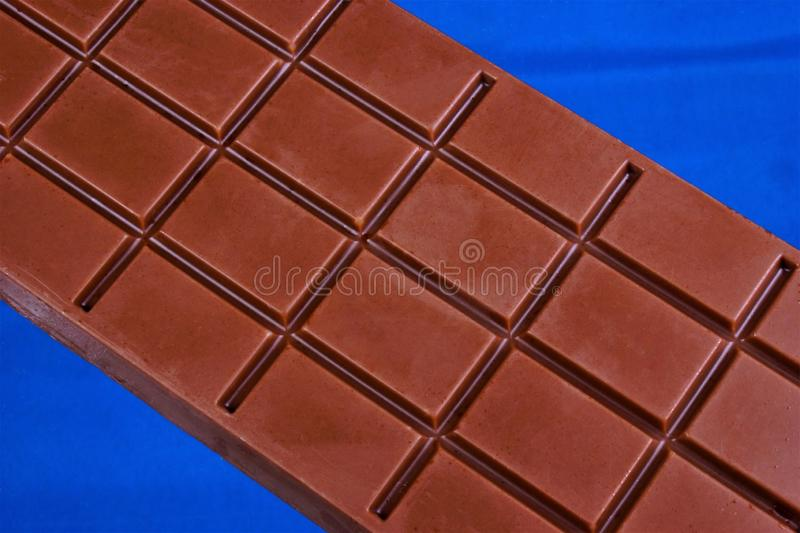 Chocolate bar confectionery is a sweet delicacy made from cocoa beans, powdered sugar and cocoa butter — the seeds of a tropical royalty free stock photography