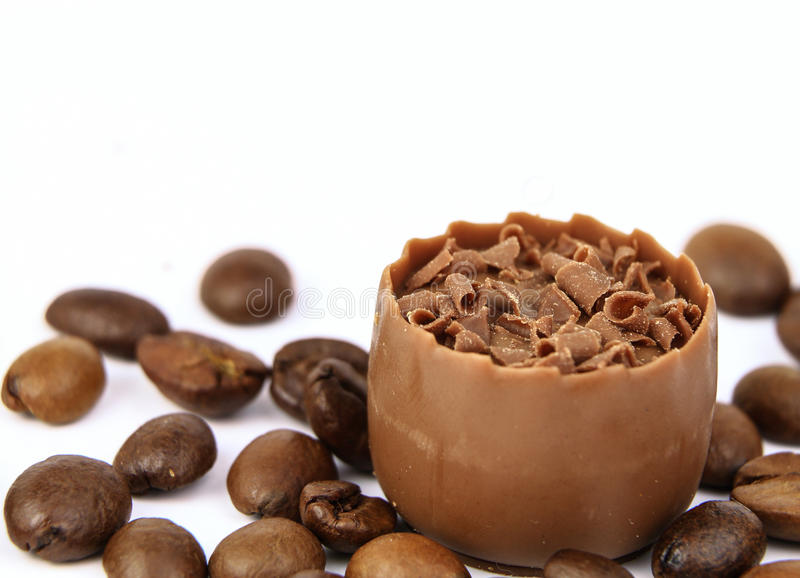 Chocolate confectionery with coffee beans isolated on white. Confectionery with coffee beans isolated on white royalty free stock image