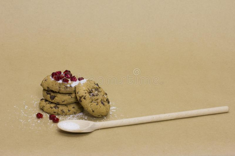 Chocolate cookies dredged with pomegranate and coconut stock photography