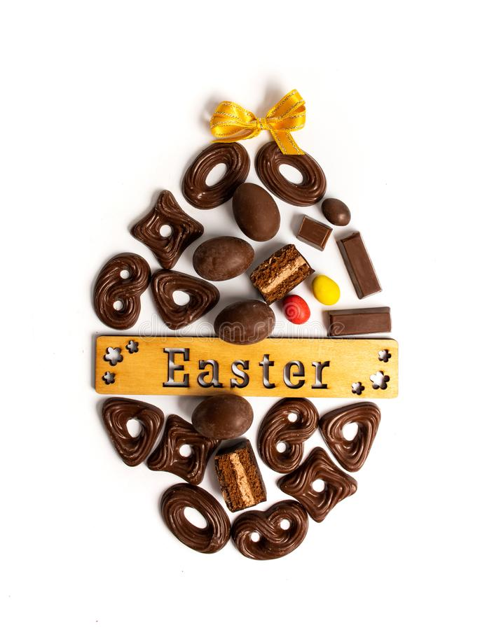 Chocolate cookies and Easter holiday card. Chocolate cookies and Easter holiday arranged card egg arrangement note text isolated food candy eggs inscribed royalty free stock photography