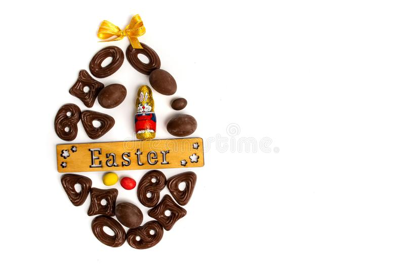 Chocolate cookies and Easter holiday card. Chocolate cookies and Easter holiday arranged card egg arrangement note text isolated food candy eggs inscribed royalty free stock photo