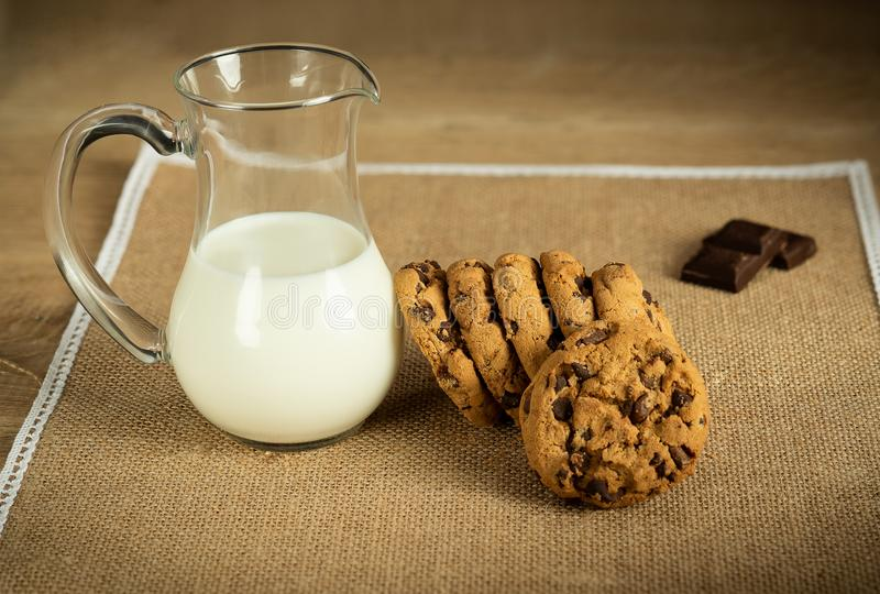 Chocolate cookies and jug of milk delicious traditional food snack stock photo