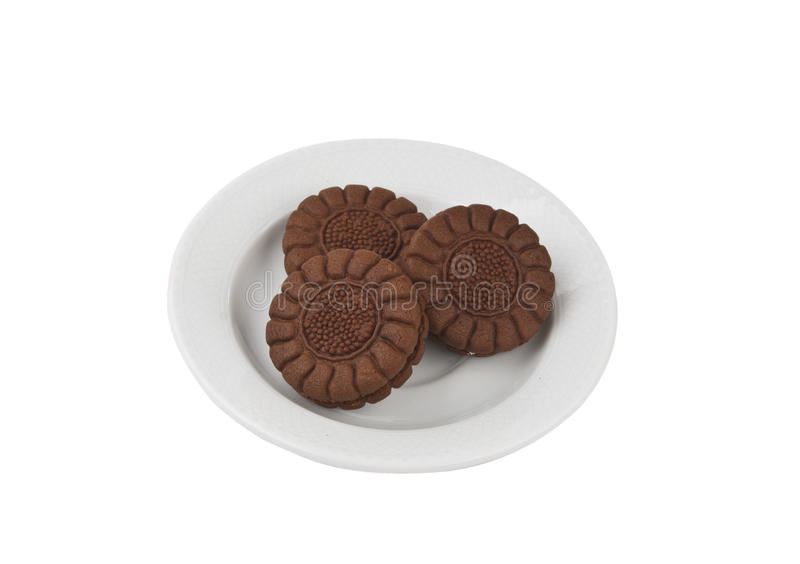 Chocolate cookies on a withe plate isolated stock images