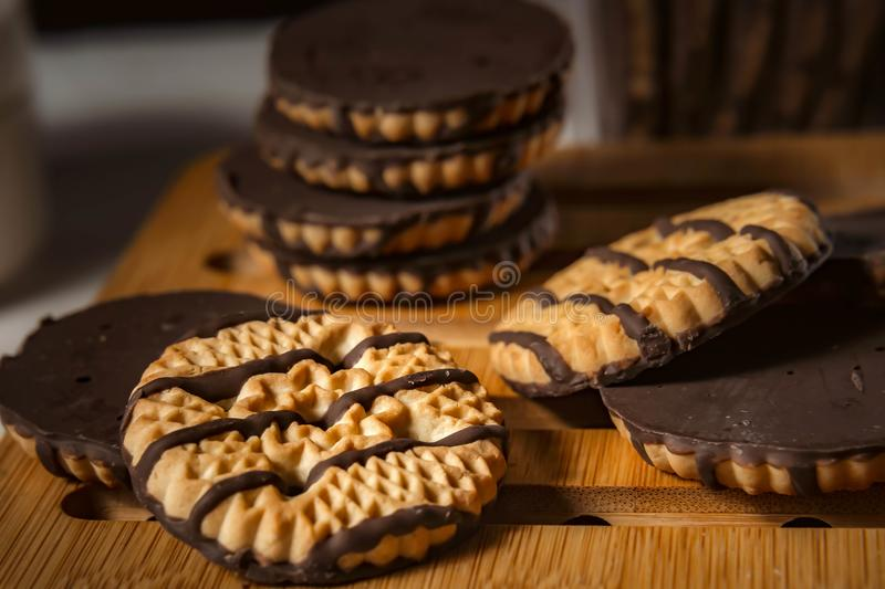 Chocolate cookies on wooden table. Closeup Shortbread cookies chocolate for morning breakfast stock photography