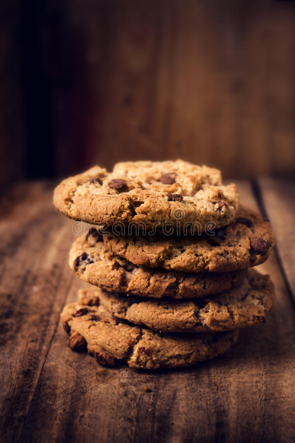 Chocolate cookies on wooden table. Stacked Chocolate chip cookie stock photography