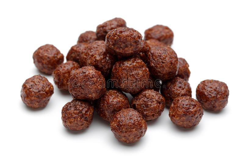 Chocolate corn balls on white background. Cornflakes, cereals royalty free stock image