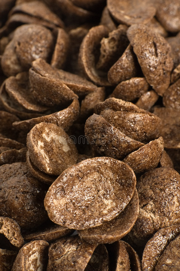 Chocolate corn flakes. Several brown chocolate corn flakes detail photo stock photography