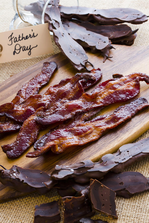 Chocolate covered bacon. With salt stock photo