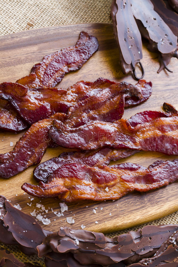 Chocolate covered bacon. With salt royalty free stock photography
