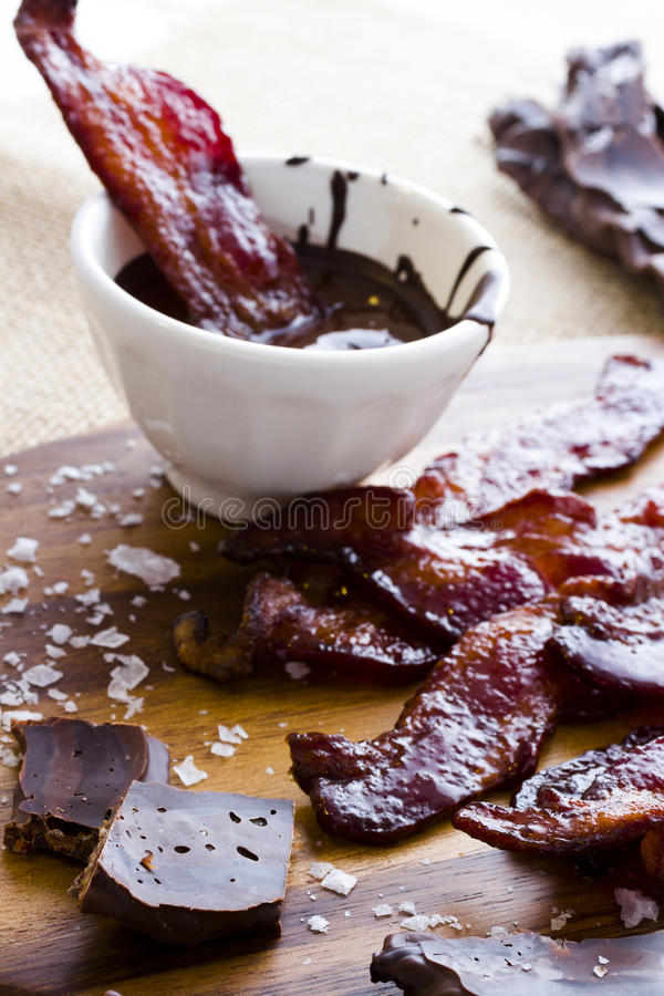 Chocolate covered bacon. With salt royalty free stock photo