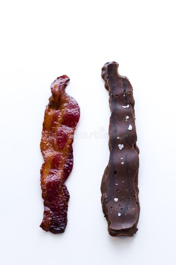 Chocolate covered bacon. With salt stock photos