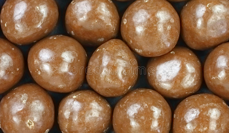 Chocolate Covered Carmel Balls up Close. A close view of round chocolate covered soft carmel candy balls royalty free stock photography
