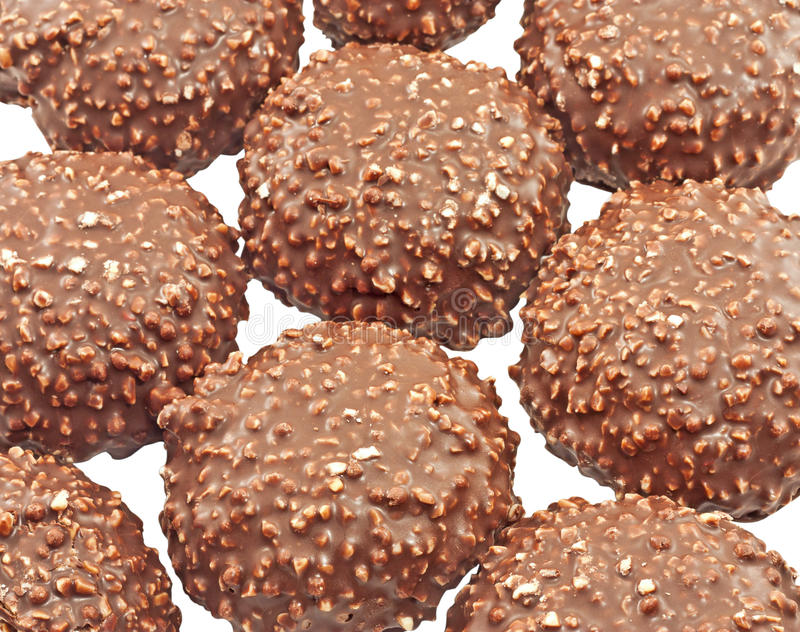 Chocolate covered cookies. Cookies covered with chocolate and nuts close up isolated stock photography