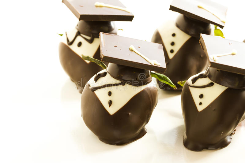 Chocolate covered strawberries. Gourmet chocolate covered strawberries decorated for graduation party royalty free stock image
