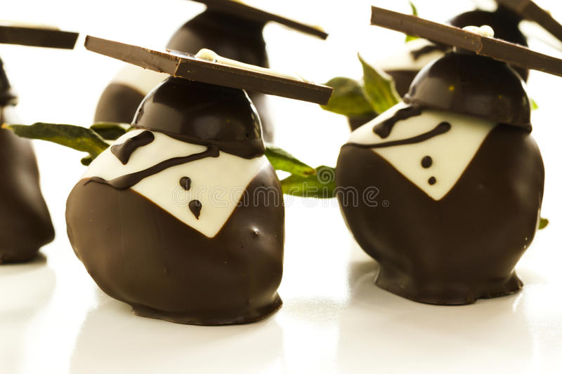 Chocolate covered strawberries. Gourmet chocolate covered strawberries decorated for graduation party stock images