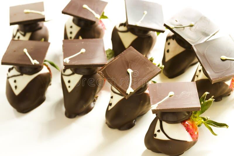 Chocolate covered strawberries. Gourmet chocolate covered strawberries decorated for graduation party stock photo