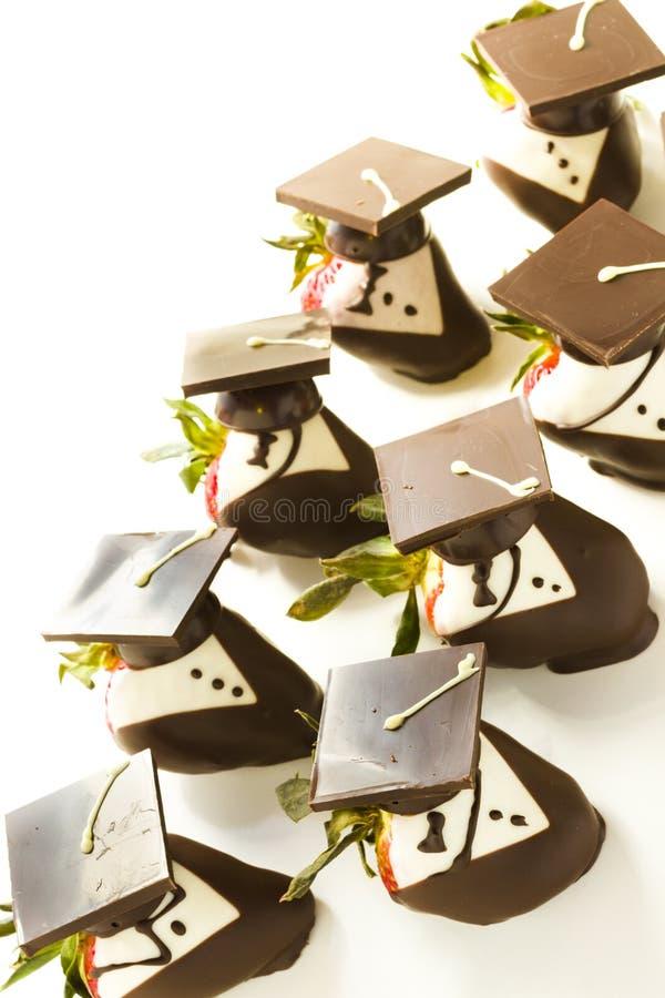 Chocolate covered strawberries. Gourmet chocolate covered strawberries decorated for graduation party stock image