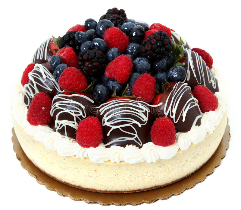 Chocolate Covered Strawberry and Fruit Cheesecake. Cheesecake topped with fresh berries and chocolate diped strawberries royalty free stock images