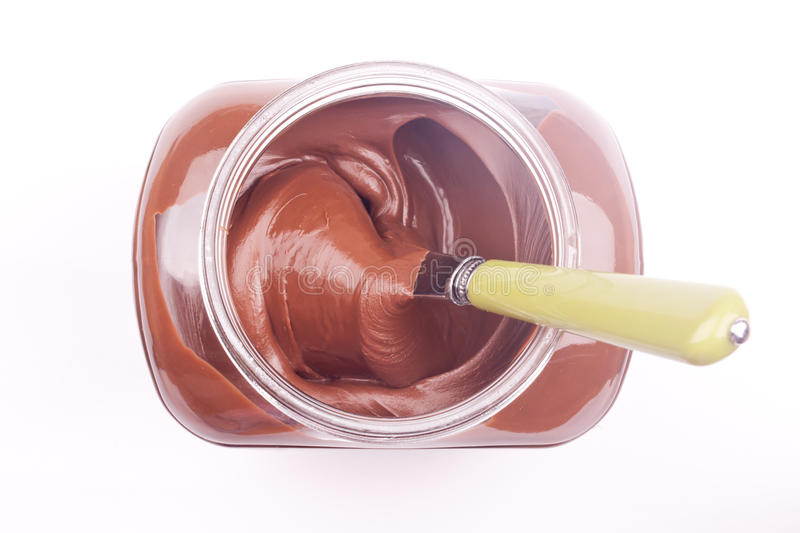 Chocolate cream. With knife on a white a background stock images