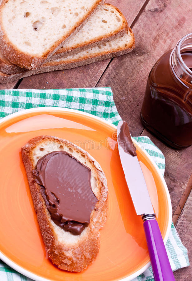 Chocolate cream and bread royalty free stock image