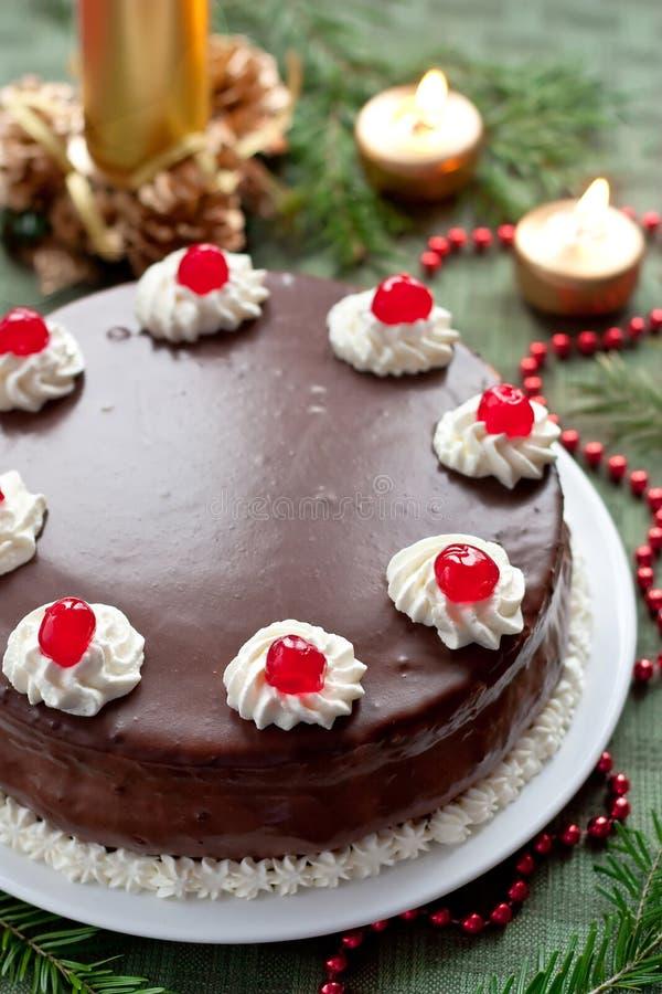 Chocolate and cream cherry birthday cake. On a festive table royalty free stock photos