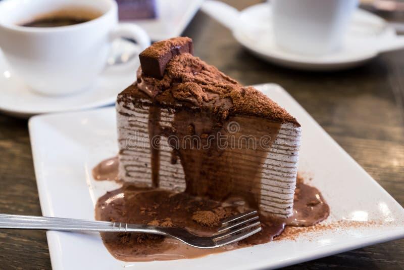Chocolate crepe cake. Topping with chocolate sauce stock photos