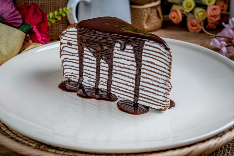 Chocolate crepe cake on white plate royalty free stock images
