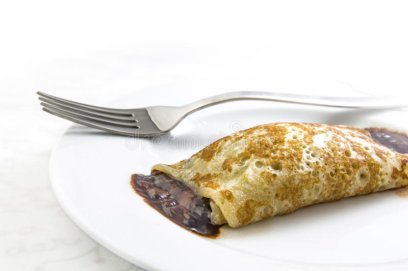 Chocolate crepe on dish stock images