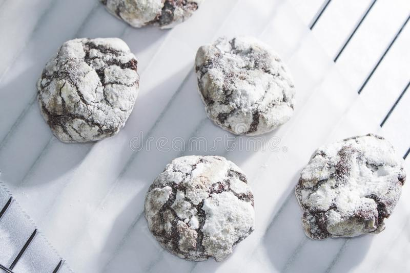 Chocolate crinkle biscuits on a baking paper, isolated royalty free stock photo