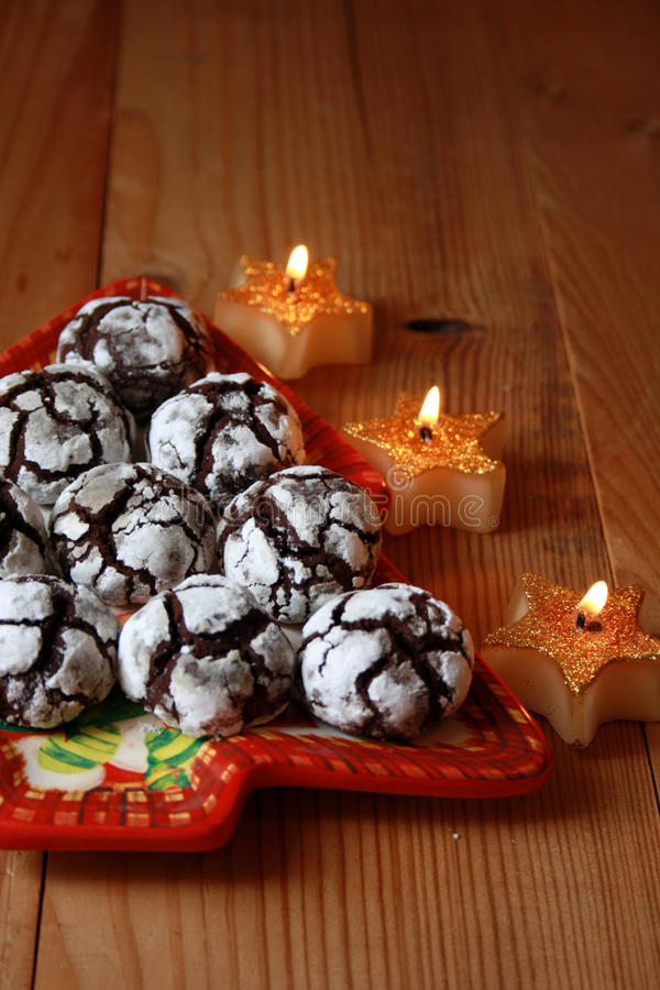 Chocolate crinkles. On a plate and candles in the shape of stars royalty free stock images